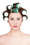 Beautiful girl is having hair curlers Stock Photos