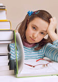 Beautiful girl having a lot of homework Royalty Free Stock Photo