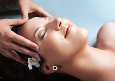 Beautiful girl having massage in spa. Royalty Free Stock Images