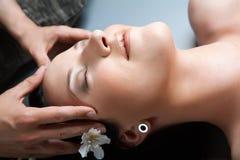 Beautiful girl having massage in spa Royalty Free Stock Photos
