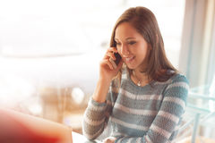 Beautiful girl having a phone call Stock Photo