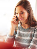 Beautiful girl having a phone call Stock Images