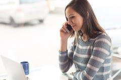 Beautiful girl having a phone call Stock Image