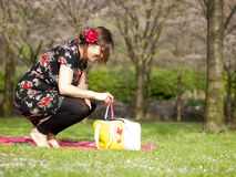 Beautiful girl having a picnic in the spring Stock Image