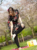 Beautiful girl having a picnic in the spring Royalty Free Stock Image