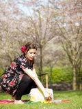 Beautiful girl having a picnic in the spring Royalty Free Stock Images