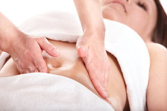 Beautiful  girl having stomach massage. Royalty Free Stock Photo