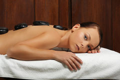 Beautiful girl having a stone therapy Stock Photography