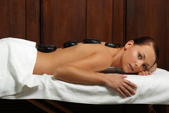Beautiful girl having a stone therapy Stock Images