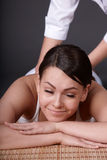 Beautiful  girl having thai massage. Stock Image
