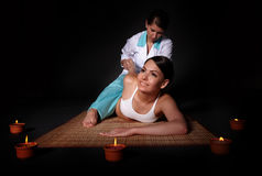 Beautiful  girl having thai massage. Royalty Free Stock Photos
