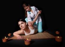 Beautiful girl having thai massage. Royalty Free Stock Photos