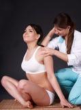 Beautiful girl having thai massage. Stock Photos