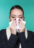 Beautiful girl having winter cold season symptoms concept. Beautiful girl having health troubles with season cold and allergy with paper tissue stock photography
