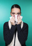 Beautiful girl having winter cold season symptoms concept. Beautiful girl having health troubles with season cold and allergy with paper tissue royalty free stock photography