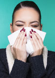 Beautiful girl having winter cold season symptoms concept. Beautiful girl having health troubles with season cold and allergy with paper tissue royalty free stock images