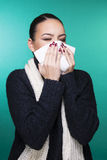Beautiful girl having winter cold season symptoms concept. Beautiful girl having health troubles with season cold and allergy with paper tissue stock photos