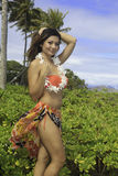 Beautiful girl in a hawaii garden Royalty Free Stock Photos