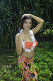 Beautiful girl in a hawaii garden Stock Images