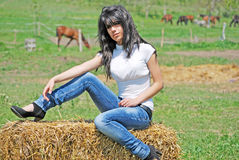 Beautiful girl on a hay bale Stock Photo