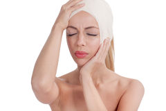 Beautiful girl with head bandages,plastic surgery cosmetology co Royalty Free Stock Photos