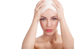 Beautiful girl with head bandages,plastic surgery cosmetology co Royalty Free Stock Photography