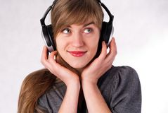 Beautiful girl with headphones Royalty Free Stock Images