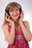 Beautiful girl with headphones Stock Images