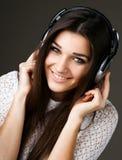 Beautiful girl in headphones Royalty Free Stock Images