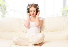 Beautiful girl in headphones enjoying music Stock Photo