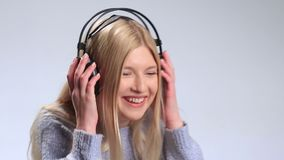 Beautiful girl with headphones enjoying music stock video footage
