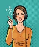 Beautiful girl in headphones listening to music. Pop art retro comic style. Cartoon vector illustration. Beautiful girl in headphones listening to music. Pop art Royalty Free Stock Images
