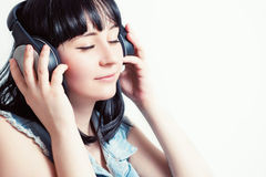 Beautiful girl with headphones listening to music. Stock Photo