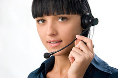 Beautiful girl with headset. Young beautiful girl with headphones with microphone in call center royalty free stock image