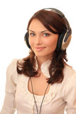 Beautiful girl in headsets Stock Photography