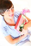 Beautiful girl with heart box and flower. For valentines day royalty free stock photo