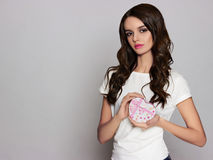 Beautiful girl with heart gift box Stock Photo