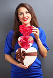 Beautiful girl with heart shape gifts Royalty Free Stock Photography