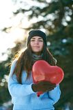 Beautiful girl with heart shaped balloon in hands royalty free stock photo