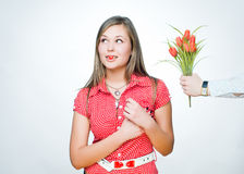 Beautiful girl with heart-shaped candy Royalty Free Stock Photos