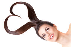 Beautiful girl with heart shaped hair Stock Photography