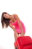Beautiful girl with heavy suitcase for travel Royalty Free Stock Images