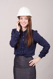 Beautiful girl in helmet talking on phone Stock Images