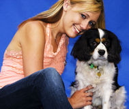 Beautiful girl with her Cavalier Spaniel Royalty Free Stock Image