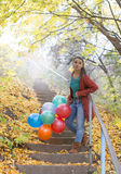 Beautiful girl with her collored balloons Royalty Free Stock Images