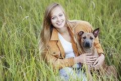Beautiful girl and her dog Stock Photography