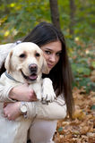 Beautiful girl with her dog in nature Royalty Free Stock Photography