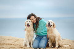 Beautiful girl with her dog near sea Stock Image
