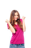 Beautiful girl with her fists up. I am winner! Happy beautiful girl with her fists up, isolated on white Stock Photo