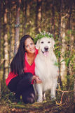 Beautiful girl with her golden retriever dog Royalty Free Stock Photos